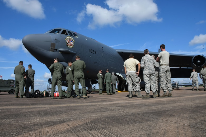 Airmen from the 307th Bomb Wing, 7th BW and 2nd BW gather around a recently arrived B-52 Stratofortress at Royal Air Force Fairford, United Kingdom, Sep. 1, 2017.