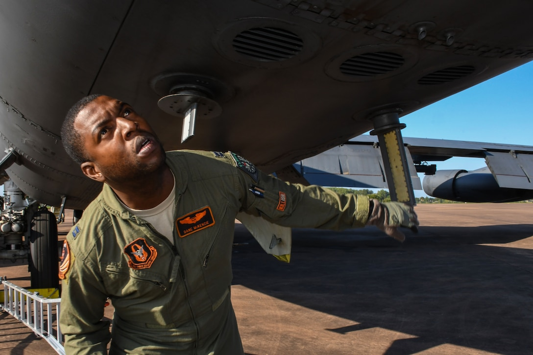 U.S. Air Force Capt. Dane McKenzie, 343rd Bomb Squadron electronic warfare officer, inspects a B-52 Stratofortress prior to flying a mission from Royal Air Force Fairford, United Kingdom, Sep. 1, 2017.