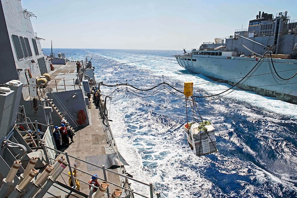 Food and fuel like these being transferred during a replenishment at sea on the African coast are among items DLA buys from African businesses to decrease customers' storage costs and support the local economy.