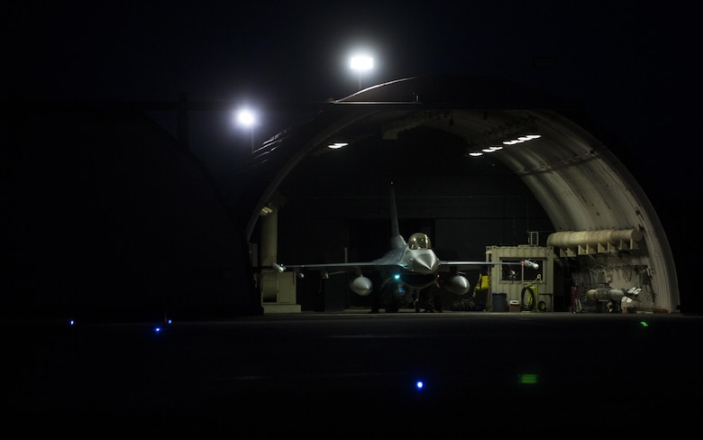 A U.S. Air Force F-16 Fighting Falcon sits parked in a hangar prior to pre-flight inspections at Kunsan Air Base, Republic of Korea, Aug. 23, 2017. Airmen assigned to the 8th Fighter Wing participated in Beverly Pack 17-3, a five-day, regularly-scheduled operational readiness exercise, which tested the base's ability to respond to various scenarios in a contingency environment. (U.S. Air Force photo by Staff Sgt. Victoria H. Taylor/Released)