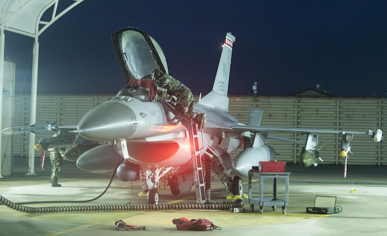 A U.S. Air Force crew chief, assigned to the 115th Fighter Wing, Wisconsin Air National Guard, performs maintenance on an F-16 Fighting Falcon at Kunsan Air Base, Republic of Korea, Aug. 22, 2017. The 115th Fighter Wing participated in a regularly-scheduled operational readiness exercise, Beverly Pack 17-3, as part of a Theater Security Package deployment to Kunsan. Pacific Air Forces TSPs signify a continued commitment to regional stability and security, while allowing units to train in the Pacific theater. (U.S. Air Force photo by 2nd Lt. Brittany Curry/Released)