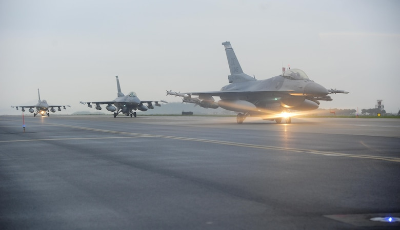 U.S. Air Force F-16 Fighting Falcons line up for an elephant walk at Kunsan Air Base, Republic of Korea, Aug. 22, 2017. The F-16 is a multi-role fighter aircraft, capable of close air support for ground forces and dominating enemy air assets in air-to-air combat. The elephant walk was a part of a regularly-scheduled operational readiness exercise, Beverly Pack 17-3, which tested the base's ability to respond to various scenarios in a contingency environment.  (U.S. Air Force photo by Senior Airman Colby L. Hardin/Released)