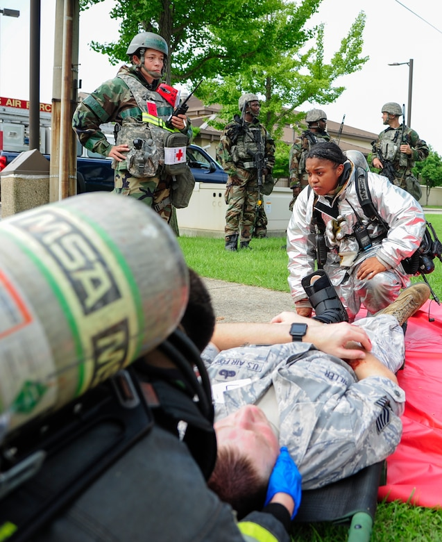 U.S. Air Force Airman 1st Class Rachel Walker-Zamora, 8th Civil Engineering Squadron firefighter, prepares to strap a simulated car accident victim to a medical litter during training exercise Beverly Pack 17-3, at Kunsan Air Base, Republic of Korea, Aug. 22, 2017. This exercises tested Kunsan first responders on time and effectiveness during a high stress environment. (U.S. Air Force photo by Senior Airman Colby L. Hardin/Released)
