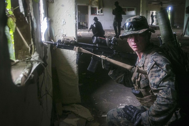 Lance Cpl. Cody L. Jowers provides security after his team cleared an abandoned house