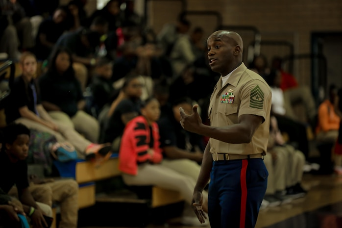 Sergeant Major Brian Priester, 13th Marine Expeditionary Unit sergeant major, speaks to students on their first day of school at Pershing High School in Detroit, Sept. 5, 2017.