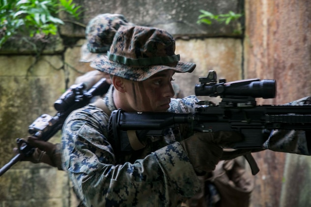 Marines with Battalion Landing Team, 3rd Battalion, 5th Marines, conduct Military Operations in Urbanized Terrain (MOUT) training at Andersen South Air Force Base, Guam, August 30, 2017