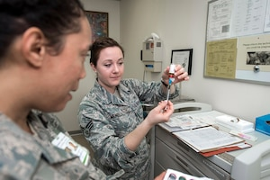 Air Force Senior Airman Taryn Mendoza, right, prepares a syringe at Misawa Air Base, Japan. DLA Troop Support's Medical supply chain provides more than 25,000 pharmaceuticals to military healthcare providers around the world. Mendoza is a medical technician with the 35th Medical Operations Squadron.