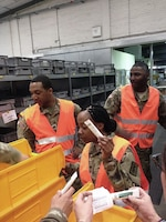Army medical supply specialists Spc. Tevin Beaty, Spc. Brittany Griffie and Sgt. Lorrence Wilder sort materials for packaging at U.S. Army Medical Materiel Center Europe in Pirmasens, Germany. DLA Troop Support's Medical supply chain employees work with USAMMCE personnel to connect U.S. military healthcare providers with more than 1,000 pharmaceutical manufacturers.