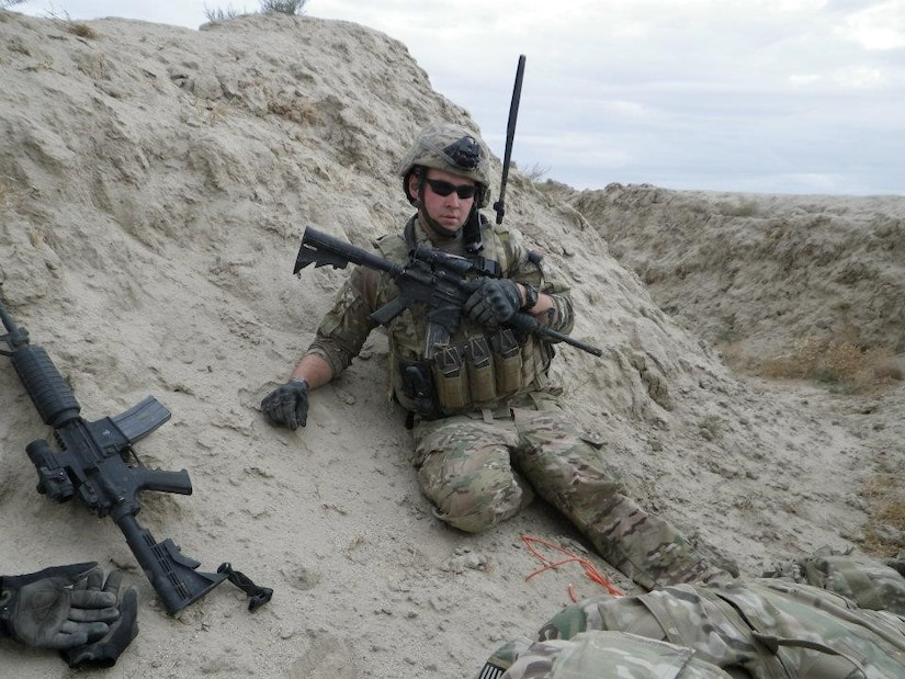 U.S. Air Force Staff Sgt. Timothy Donnan, 633rd Civil Engineer Squadron Explosives Ordnance Disposal team lead, poses for a photo in Afghanistan. (courtesy photo)
