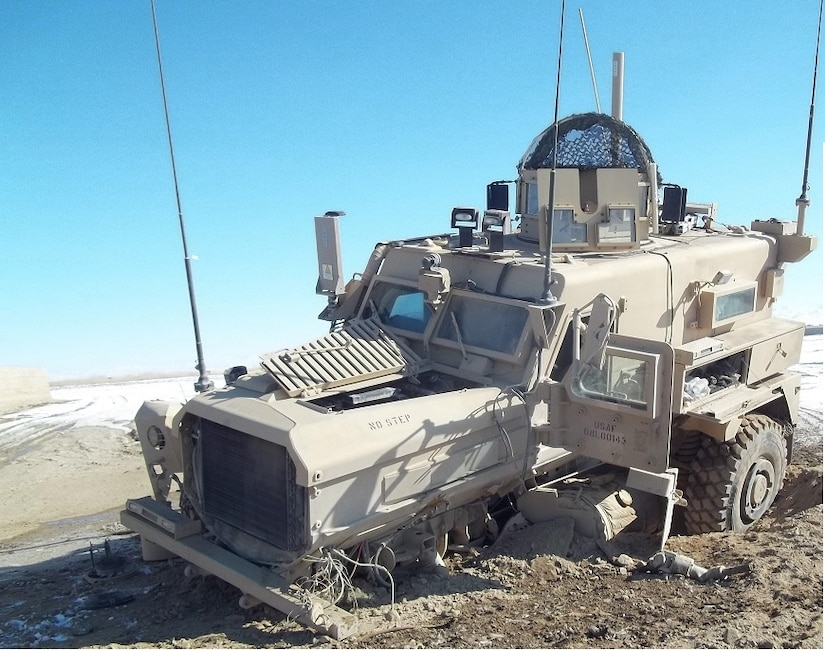 The broke-down vehicle of U.S. Air Force Staff Sgt. Timothy Donnan, 633rd Civil Engineer Squadron Explosives Ordnance Disposal team lead, sits after it was hit by an Improvised Explosive Device in Afghanistan, Jan. 16, 2012. (courtesy photo)