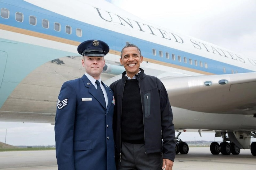 U.S. Air Force Staff Sgt. Timothy Donnan, 633rd Civil Engineer Squadron Explosives Ordnance Disposal team lead, poses with former President Barak Obama. (courtesy photo)