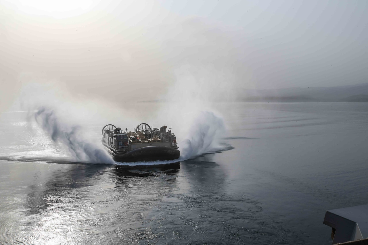 An air-cushioned landing craft approaches the amphibious transport dock ship USS San Diego during exercise Alligator Dagger off the coast of Djibouti