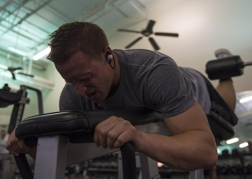 U.S. Air Force 1st Lt. James LaCoste, 633rd Force Support Squadron chief career development element, performs a lying leg curl at Joint Base Langley-Eustis, Va., July 20, 2017. LaCoste has been weightlifting for more than 13 years and credits his foundation in bodybuilding to his father. (U.S. Air Force photo by Staff Sgt. J.D. Strong II)