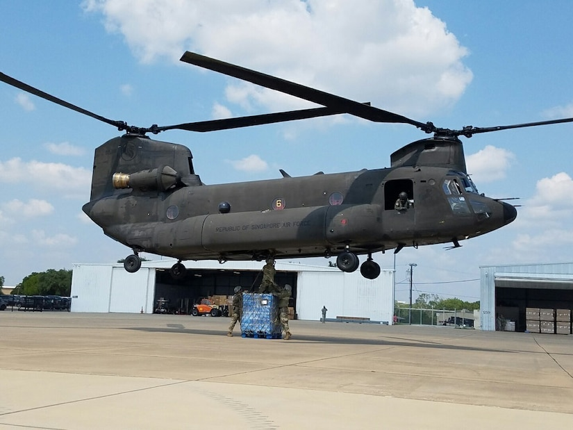 Texas Army National Guardsmen with the 372nd Combat Sustainment Support Battalion conduct external sling load resupply operations with the Singaporean Air Force's Peace Prairie Detachment during operations in support of Task Force Harvey, Aug. 30, 2017. This unique capability provided much needed forward distribution of food and water to soldiers at Logistics Support Area Brenham. Texas Army National Guard photo by Staff Sgt. Jerod Zuniga