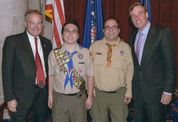 IMAGE: WASHINGTON - NSWC Dahlgren Division engineer Jose Lugo and his son Christian Lugo - an Eagle Scout from King George Boy Scout Troop 191 - are pictured with U.S. Senators Tim Kaine (D-Va.) and Mark Warner (D-Va.) at a recent Scouting recognition event held in the Russell Senate Office Building.