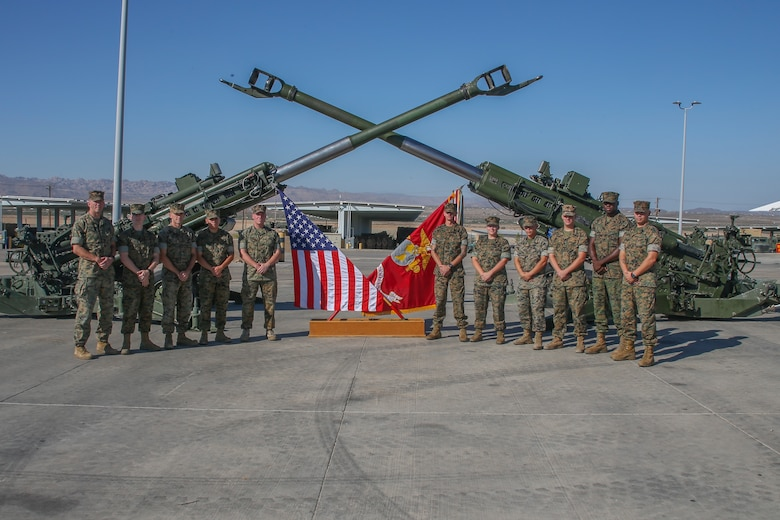 U.S. Marines with 3rd Battalion, 11th Marines, pose for a group photo during a mass reenlistment ceremony aboard the Marine Corps Air Ground Combat Center, Twentynine Palms, Calif., Aug 24, 2017.