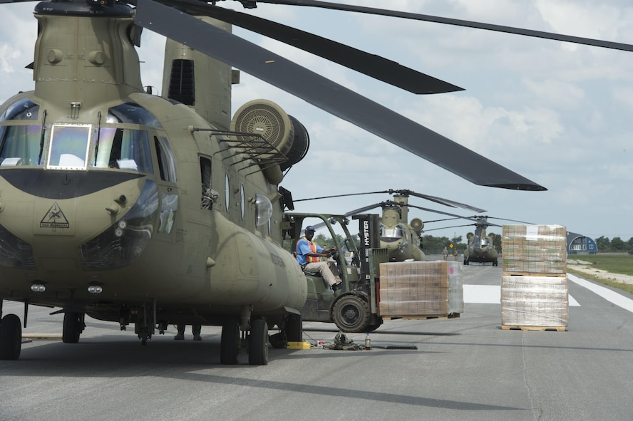 A Defense Logistics Agency forklift operator prepares to pallet of MREs at JBSA Randolph Auxiliary Airfield, Seguin, Texas, Sept. 5, 2017. Three Chinooks loaded 20 pallets of MREs to to transport as part of the relief efforts for Hurricane Harvey. The category-4 hurricane, with wind speeds up to 130 miles per hour, made landfall Aug. 25, 2017. Days after the hurricane reached Texas, more than 50 inches of rain flooded the coastal region. (U.S. Air Force Photo by Tech. Sgt. Chad Chisholm/Released)