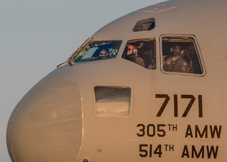 Pilots of a C-17 Globemaster III from Joint Base McGuire-Dix-Lakehurst arrive to Scott Air Force Base to pick up 375th Aeromedical Evacuation Squadron personnel and humanitarian aid cargo in support of the Hurricane Harvey relief and response efforts, Scott Air Force Base, Ill., Aug. 30, 2017.