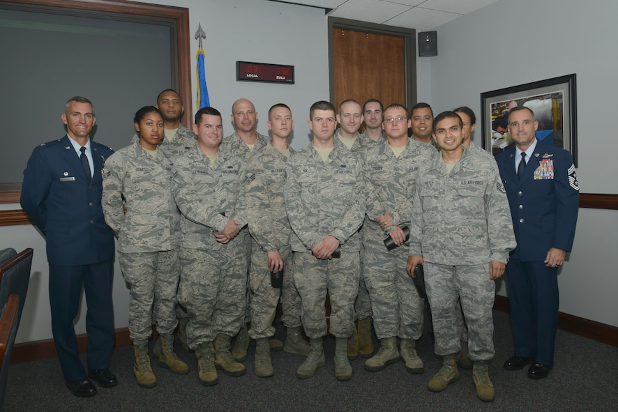 """The 20th Operations Support Squadron air traffic control and landing systems shop is recognized by 20th Fighter Wing leadership as Shaw """"Weasels of the Week"""" at Shaw Air Force Base, S.C., Sept. 6, 2017."""