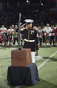 Staff Sgt. Alfredo Torres, an infantryman with 2nd Battalion, 7th Marines, places a ka-bar and rifle, in honor of the fallen Marines from 3rd Battalion, 5th Marine Regiment, during the opening ceremony of the Honor Bowl Championship Game at Cathedral Catholic High School, San Diego, Sept. 2, 2017. The Honor Bowl is an elite football tournament which highlights some of the most talented high school teams across the country, and honors service members both killed and wounded in action. (U.S. Marine Corps Photo by Sgt. Taylor Morton/Released)