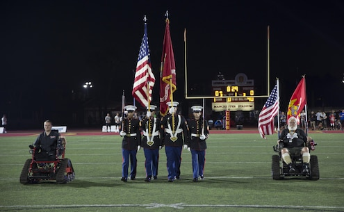U.S. Marines with Recruiting Station San Diego, Color Guard present the colors during the opening ceremony of the Honor Bowl Championship Game at Cathedral Catholic High School, San Diego, Sept. 2, 2017. The Honor Bowl is an elite football tournament which highlights some of the most talented high school teams across the country, and honors service members both killed and wounded in action. (U.S. Marine Corps Photo by Sgt. Taylor Morton/Released)