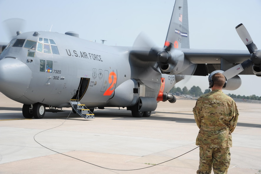 A Modular Airborne Fire Fighting System equipped C-130 Hercules aircraft from the Air Force Reserve's 302nd Airlift Wing prepares to depart Peterson Air Force Base, Colorado, Sept. 6, 2017.