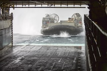 A landing craft, air cushion operated by Sailors of Assault Craft Unit 5 enters the well deck of the amphibious dock landing ship USS Pearl Harbor (LSD 52) while conducting amphibious operations in support of Alligator Dagger. Alligator Dagger is a dedicated, unilateral combat rehearsal led by Naval Amphibious Force, Task Force 51/5th Marine Expeditionary Brigade, in which combined Navy and Marine Corps units of the America Amphibious Ready Group and embarked 15th Marine Expeditionary Unit are to practice, rehearse and exercise integrated capabilities that are available to U.S. Central Command both afloat and ashore.