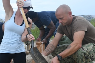Sailors fill sandbags in Florida.