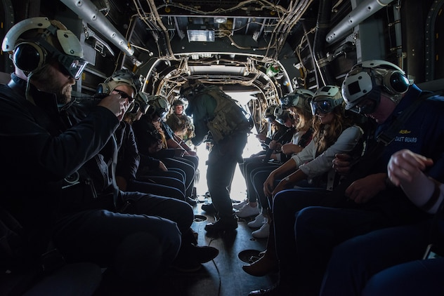 Local dignitaries from Detroit, enjoy their military experience during the MV-22 Osprey flights over Detroit as part of Marine Week, Sept. 6, 2017.