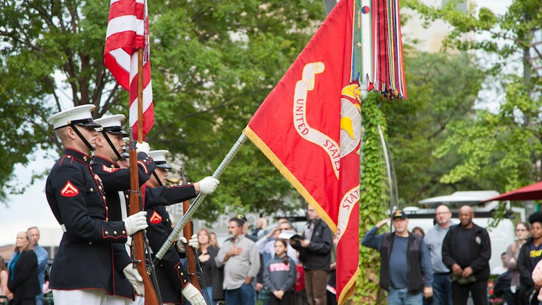 The Official Color Guard of the Marine Corps presents the colors during the  national anthem at Marine Week Detroit's opening ceremony, Sept. 6, 2017.  Marine Week Detroit is an opportunity to commemorate the unwavering support of the American people, and show the Marines Corps' continued dedication to protecting the citizens of this country.
