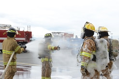 Firefighters assigned to the 673d Civil Engineer Squadron train during the foam test at Hangar 18 on Joint Base Elmendorf-Richardson, Alaska, Aug. 31, 2017. The firefighters were a part of the foam test to practice and train for rescue operations. (U.S. Air Force photo by Airman 1st Class Caitlin Russell)