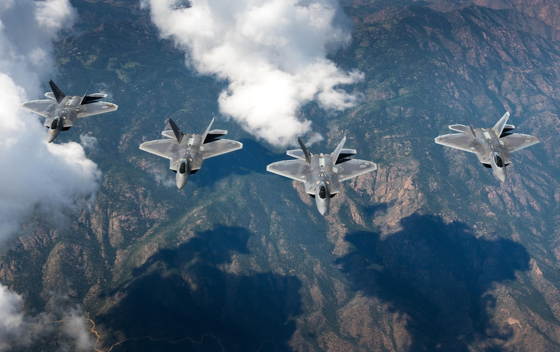 A four-ship formation of U.S. Air Force F-22 Raptors f from the 94th Fighter Squadron and 1st Fighter Wing  fly in formation over the Rocky Mountain Range in Colo., while in transit back to Joint Base Langley-Eustis, Va. after participating in Red Flag 17-4 Aug. 26, 2017. (U.S. Air Force photo by Staff Sgt. Carlin Leslie)