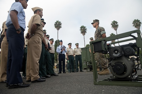 U.S. Marine Corps Lance Cpl. Erick Costa, a water support technician with Support Company, 7th Engineer Support Battalion, 1st Marine Logistics Group, explains the capabilities of the lightweight water purification system to the students from the Columbian War College's General Staff Course at Camp Pendleton, Calif., Sept. 6, 2017. The Columbian War College established the General Staff Course as a requirement for promotion to the rank of lieutenant colonel for service members in the Colombian Army, Navy and Air Force.  (U.S. Marine Corps photo by Lance Cpl. Roderick Jacquote)
