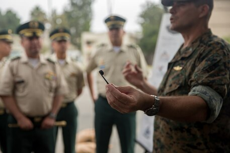U.S. Marine Corps Col. Jaime Collazo, the commanding officer of Combat Logistics Regiment 15, 1st Marine Logistics Group, presents a cobra helmet racket to the students from the Columbian War College's General Staff Course at Camp Pendleton, Calif., Sept. 6, 2017. In addition to the War College's academic master's program, the school offers specialist degrees in security and national defense, command and general-staff studies, and the promotion courses for high-ranking military officers. (U.S. Marine Corps photo by Lance Cpl. Roderick Jacquote)