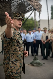 U.S. Marine Corps Col. Jaime Collazo, the commanding officer of Combat Logistics Regiment 15,1st Marine Logistics Group, describes a static display to the students from the Columbian War College's General Staff Course at Camp Pendleton, Calif., Sept. 6, 2017. The students observed parts of the U.S. military strategic war-time contingencies to apply this knowledge to their units. (U.S. Marine Corps photo by Lance Cpl. Roderick Jacquote)