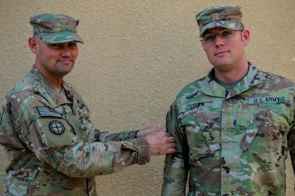 US Army Soldier Puts Combat Patch On Another Soldiers Uniform