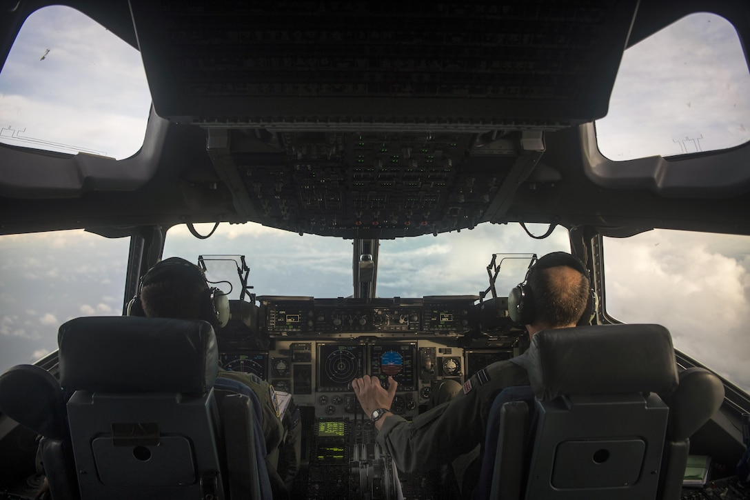 Interior of a C-17 Globemaster cockpit during take off.