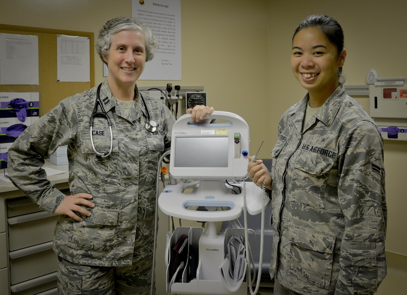 """U.S. Air Force Capt. Candra Case, a family health physician assistant, and Airman 1st Class Ma Sekina Sanvictores, an aerospace medical service technician, both assigned to the 6th Medical Support Operations Squadron, pause for a photo in the 6th Medical Group Clinic at MacDill Air Force Base, Fla., Sept. 1, 2017. The mission of the family health clinic, as well as the 6th Medical Group, is to prepare, prevent, heal and deploy, also known as """"P2HD."""" (U.S. Air Force photo by Senior Airman Mariette Adams)"""