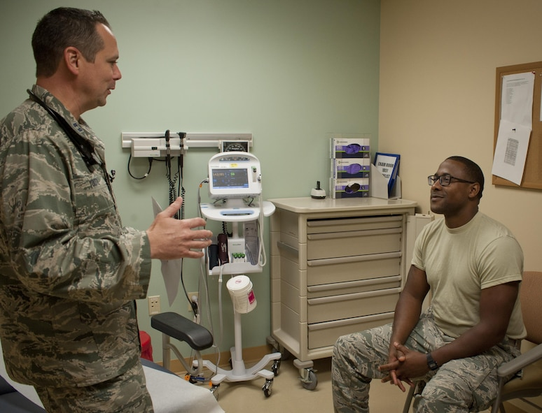 U.S. Air Force Capt. Gregory Youtz, a family health physician assistant assigned to the 6th Medical Support Operations Squadron, talks to a patient in the 6th Medical Group Clinic at MacDill Air Force Base, Fla., Sept. 7, 2017. The family health clinic cares for over 19,000 patients. (U.S. Air Force photo by Senior Airman Mariette Adams)