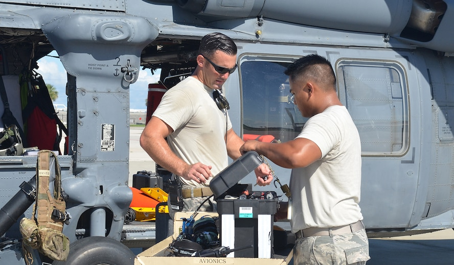 """Maintenance teams from the 920th Rescue Wing, Patrick Air Force Base, Florida, ready its wings to be relocated September 7 in response to Hurricane Irma's projected path and to pre-position for rescue efforts after the storm if needed. Aircrews flew three HH-60G """"Jolly"""" Pave Hawk helicopters to Orlando; and two HC-130P/N """"King"""" fixed-wing aerial refueling aircraft to Georgia; while pararescue teams configured as a rescue assets in case they are called into action from the aftermath of the storm. (U.S. Air Force photo/Maj. Cathleen Snow)"""