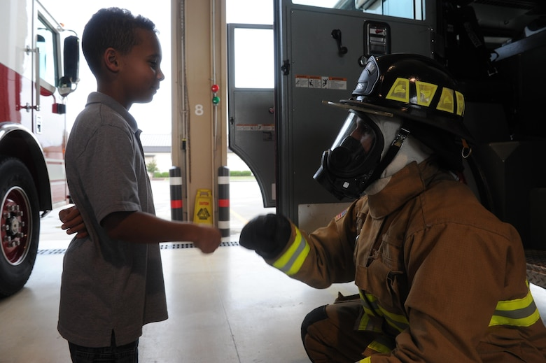 Young Hurlburt hero named honorary firefighter