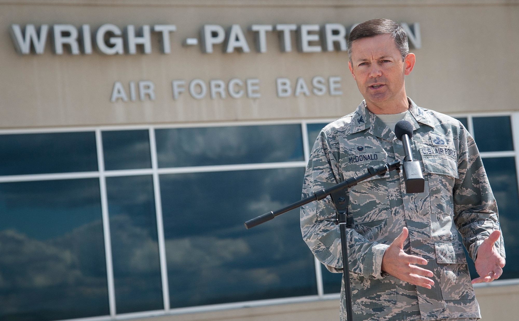 Installation commander and 88th Air Base Wing Commander Col. Bradley McDonald briefs the media on plans to receive Air Force aircraft evacuating from areas being affected by Hurricane Irma. (U.S. Air Force photo/Jim Varhegyi)