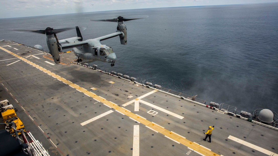 A Marine Corps MV-22B Osprey aircraft assigned to Marine Medium Tiltrotor Squadron 162 (Reinforced), 26th Marine Expeditionary Unit, lands aboard the amphibious assault ship USS Kearsarge.