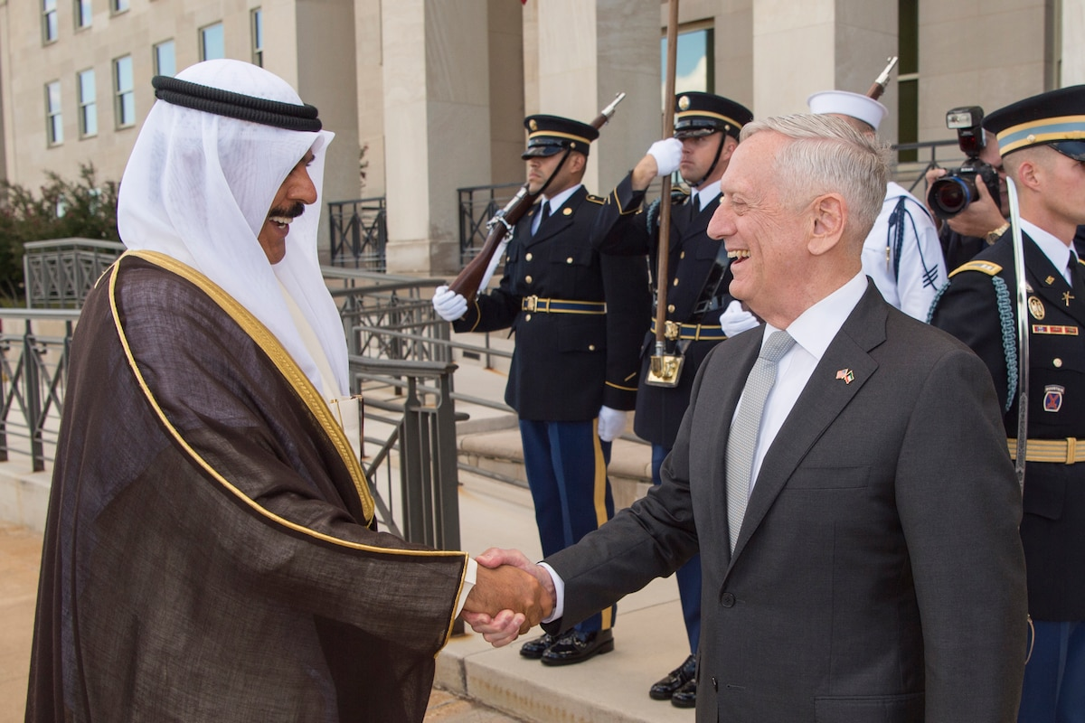 Defense Secretary James N. Mattis shakes hands with his Kuwaiti counterpart at the Pentagon.