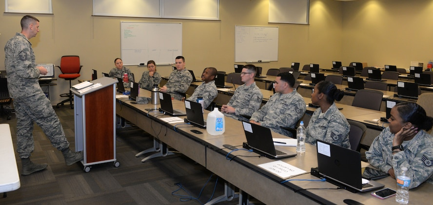 Tech. Sgt. William J. Hyche III the section chief for pavements and equipment, assigned to the 28th Civil Engineer Squadron, offers his opinion in an open discussion Sept. 5, 2017, on Ellsworth Air Force Base, S.D. Course facilitators focused more on lectures an open discussions rather than slide shows. (U.S. Air Force photo by Airman 1st Class Thomas Karol)