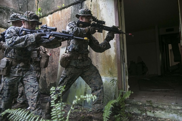 Marines with Battalion Landing Team, 3rd Battalion, 5th Marines, clear an abandoned house during Military Operations in Urbanized Terrain (MOUT) training at Andersen South Air Force Base, Guam, August 30, 2017. Marines with BLT 3/5 train regularly in different environments to maintain their readiness as the Ground Combat Element of the 31st Marine Expeditionary Unit. The 31st MEU partners with the Navy's Amphibious Squadron 11 to form the Bonhomme Richard Expeditionary Strike Group, providing a cohesive blue-green team capable of accomplishing a variety of missions across the Indo-Asia-Pacific region. (U.S. Marine Corps photo by Cpl. Amaia Unanue/Released)