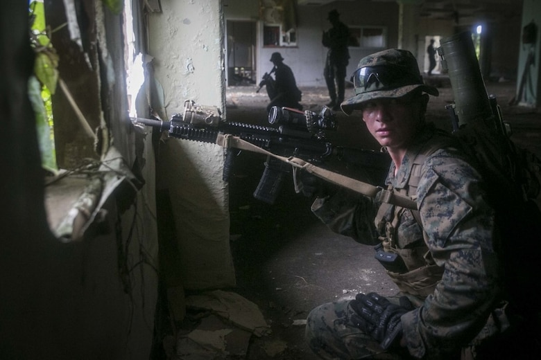 Lance Cpl. Cody L. Jowers, a rifleman with India Company, Battalion Landing Team, 3rd Battalion, 5th Marines, sets security during Military Operations in Urbanized Terrain (MOUT) training at Andersen South Air Force Base, Guam, August 30, 2017. Marines with BLT 3/5 train regularly in different environments to maintain their readiness as the Ground Combat Element of the 31st Marine Expeditionary Unit. The 31st MEU partners with the Navy's Amphibious Squadron 11 to form the Bonhomme Richard Expeditionary Strike Group, providing a cohesive blue-green team capable of accomplishing a variety of missions across the Indo-Asia-Pacific region. (U.S. Marine Corps photo by Cpl. Amaia Unanue/Released)