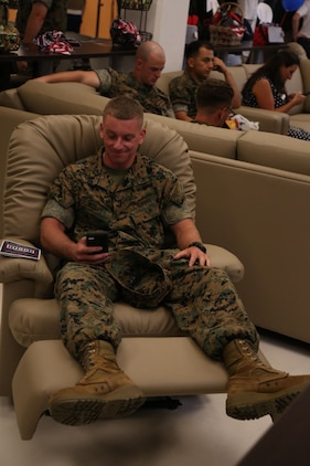 CAMP FOSTER, OKINAWA, Japan – Lance Cpl. Nicholas Mosley relaxes at the grand reopening Aug. 30 at the Camp Foster USO, Okinawa, Japan.