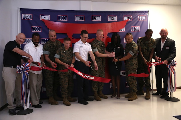 CAMP FOSTER, OKINAWA, Japan – After eight months of dedication and hard work, members of the USO, Marine Corps Installation Pacific, and Camp Foster leadership cut the reopening ribbon Aug. 30 at the Camp Foster USO, Okinawa, Japan.