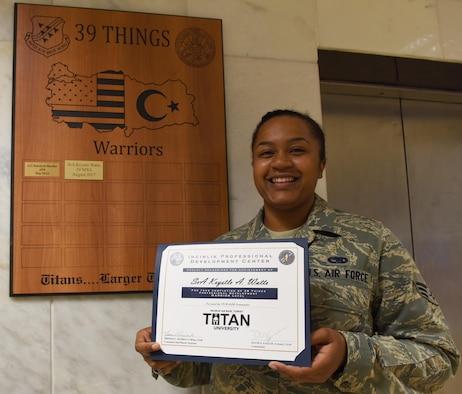 Senior Airman Krystal Watts earns the Titan University highest level of achievement.